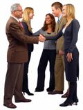 Photo of five technical communicators at work.